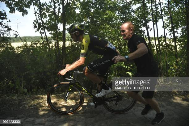 New Zealand's Jack Bauer gets going again on a cobblestone section during the ninth stage of the 105th edition of the Tour de France cycling race...