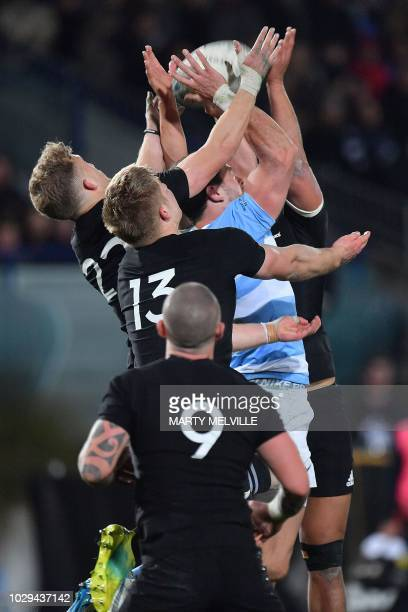 New Zealand's Jack Goodhue C Damian McKenzie and Anton LienertBrown with Argentina's Emiliano Boffellin jump for the ball during the Rugby match...