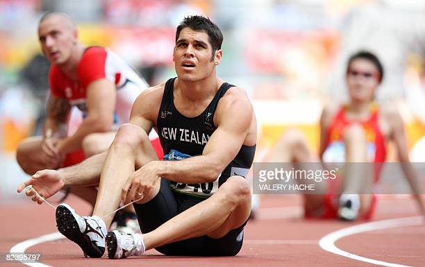 New Zealand's James Dolphin looks at the result monitor after competing in the men's first round 200m heat 8 at the Bird's Nest National Stadium...