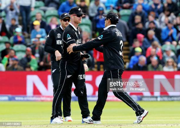 New Zealand's James Neesham finishes his ten overs of bowling 5 wickets for 31 runs and shakes hands with Ross Taylor during the ICC Cricket World...