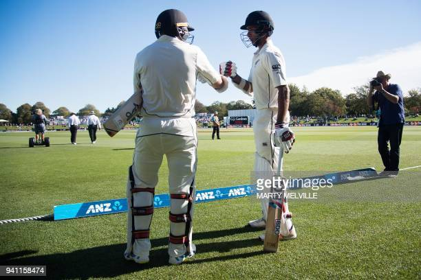 New Zealand's Jeet Raval and teammate New Zealand's Tom Latham walk onto the field during day five of the second cricket Test match between New...