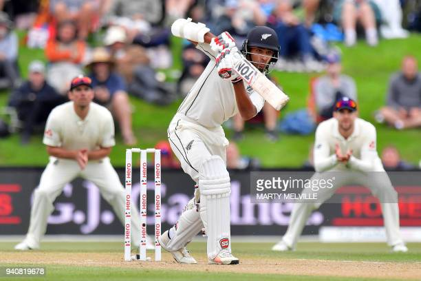 New Zealand's Jeet Raval bats watched by England's Alastair Cook and Dawid Malan during day four of the second cricket Test match between New Zealand...