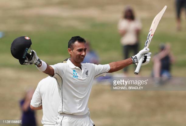 New Zealand's Jeet Raval celebrates his century during day two of the first cricket Test match between New Zealand and Bangladesh at Seddon Park in...