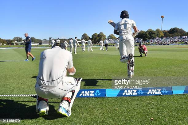 New Zealand's Jeet Raval R with team mate New Zealand's Tom Latham walks onto the field during day five of the second cricket Test match between New...
