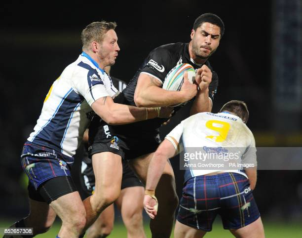 New Zealand's Jesse Bromwich is tackled by Scotland's Oliver Wilkes and Ian Henderson during the World Cup Quarter Final match at Headingley Stadium...