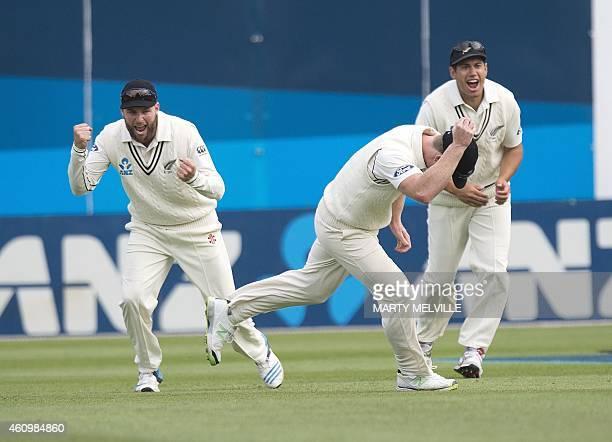 New Zealand's Jimmy Neesham catches out Sri Lanka's Prasanna Jayawardene as teammates Mark Craig and Ross Taylor celebrating on day one of the second...