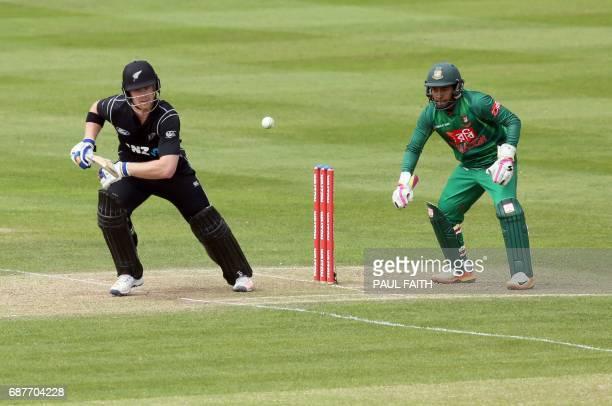 New Zealand's Jimmy Neesham plays a shot past Bangladesh keeper Rahim Mushfiqr during the TriSeries one day international cricket match between...
