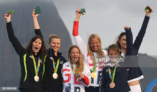 New Zealand's Jo Aleh and New Zealand's Polly Powrie , Britain's Hannah Mills and Britain's Saskia Clark and France's Camille Lecointre and France's...