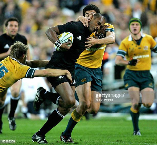 New Zealand's Joe Rokocoko , attempts to break tackle by Morgan Turinui and Drew Mitchell of Australia during the Bledisloe Cup rugby match in...