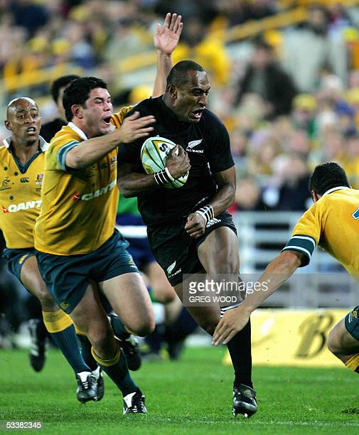 New Zealand's Joe Rokocoko , breaks a tackle by Jeremy Paul of Australia during the Bledisloe Cup rugby match in Sydney, 13 August 2005. Australia...