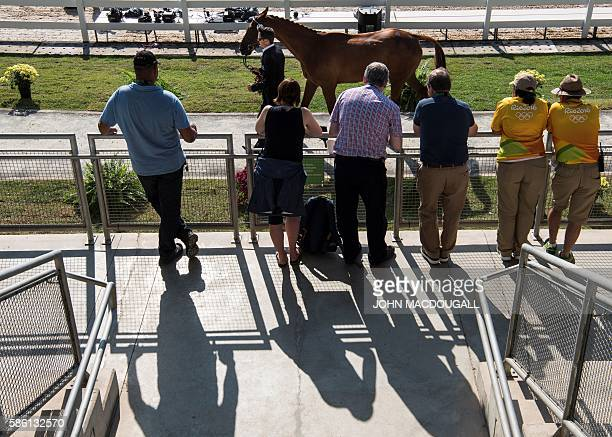 New Zealand's Jonathan Paget leads Clifton Lush to a trot during the first horse inspection of the Equestrian's Eventing phase during the 2016 Rio...