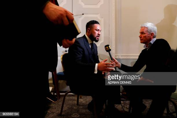 New Zealand's Joseph Parker WBO world heavyweight champion is interviewed by British sports broadcaster Mike Costello at a press conference in...