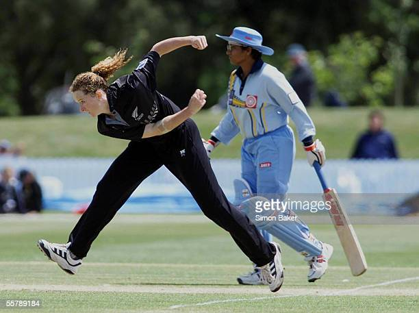 New Zealand's Katrina Keenan bowls as India's Purnima Rau looks on during their CricInfo Womens World Cup cricket match at the BIL Oval Lincoln...