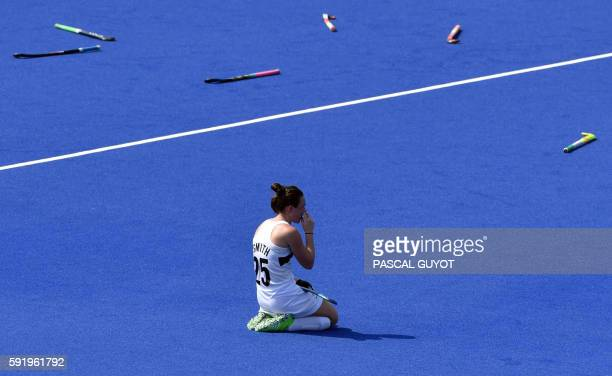 New Zealand's Kelsey Smith kneels on the pitch at the end of the women's Bronze medal hockey Germany vs New Zealand match of the Rio 2016 Olympics...