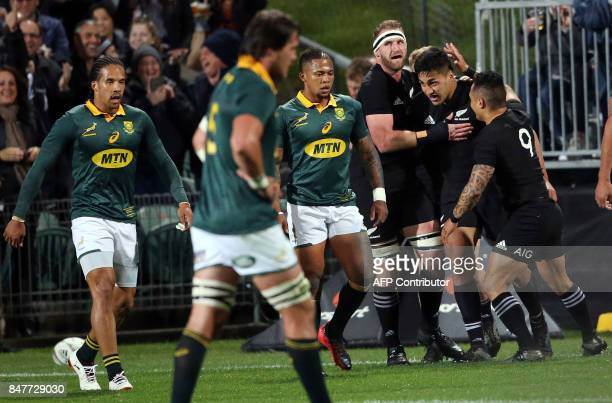 New Zealand's Kieran Read and Aaron Smith celebrate the try of Reiko Ioane during the Rugby Championship match between New Zealand and South Africa...