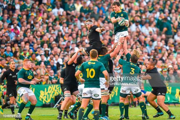 New Zealand's Kieran Read and South Africa's Franco Mostert jump in the line out during the Rugby Championship match between South Africa and New...