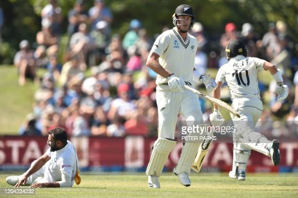 New Zealand's Kyle Jamieson and Neil Wagner make runs as India bowler Mohammed Shami misses the ball on day two of the second Test cricket match...