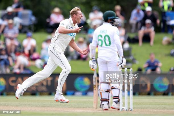 New Zealand's Kyle Jamieson celebrates Pakistan's batsman Abid Ali (R being caught during day 4 of the 2nd international cricket Test match between...