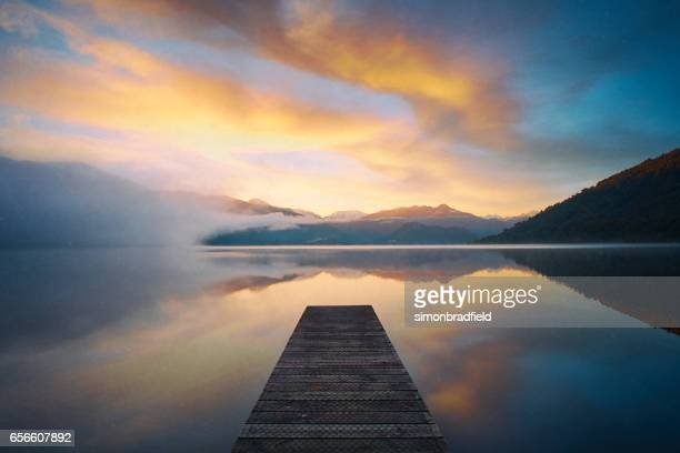 new zealand's lake kaniere at dawn - mirror lake stock pictures, royalty-free photos & images