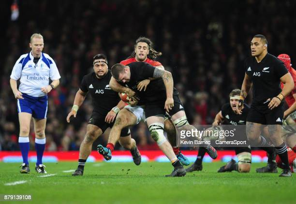 New Zealand's Liam Squire is tackled by Wales' Josh Navidi during the 2017 Under Armour Series Autumn International match between Wales and New...