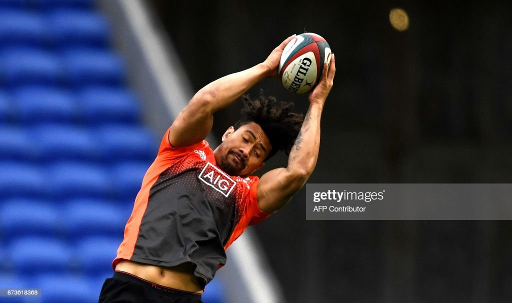 New Zealand's lock Ardie Savea grabs the ball during a training session on the eve of the friendly rugby union international match between France and New Zealand All Blacks on November 13, 2017 at the Groupama stadium in Decines-Charpieu near Lyon, southeastern France. /