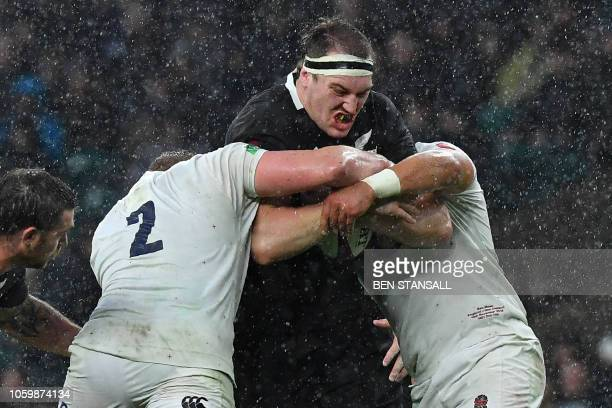 TOPSHOT New Zealand's lock Brodie Retallick is tackled during the autumn international rugby union match between England and New Zealand at...