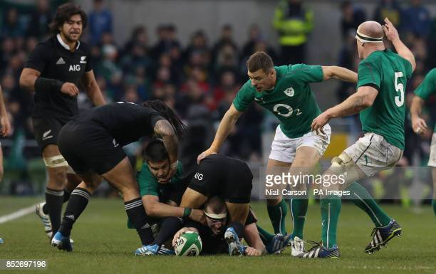 New Zealand's Luke Romano tussles with Ireland's Conor Murray during the Guinness Series match at the Aviva Stadium Dublin Ireland