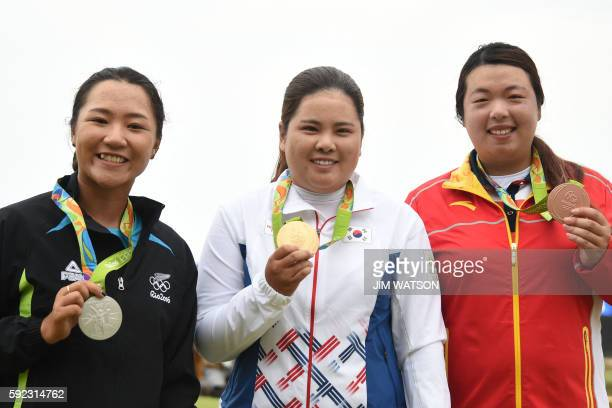 New Zealand's Lydia Ko with silver South Korea's Park Inbee with her gold medal China's Feng Shanshan with Bronze pose on the podium of the Women's...