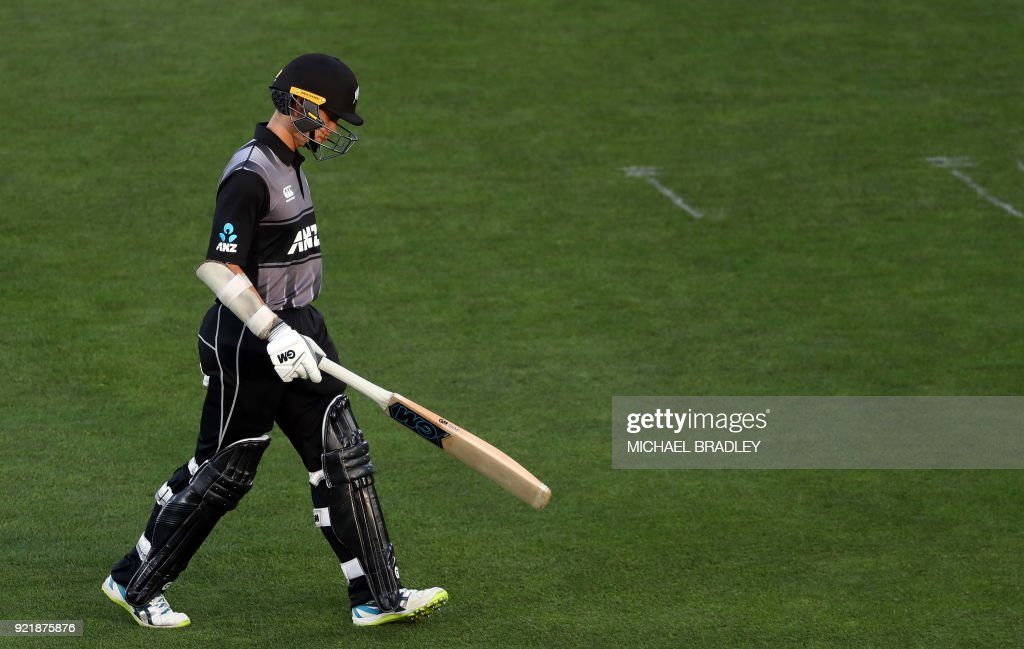 New Zealand's Mark Chapman walks off after being dismissed LBW during the final Twenty20 Tri Series international cricket match between New Zealand and Australia at Eden Park in Auckland on February 21, 2018. /