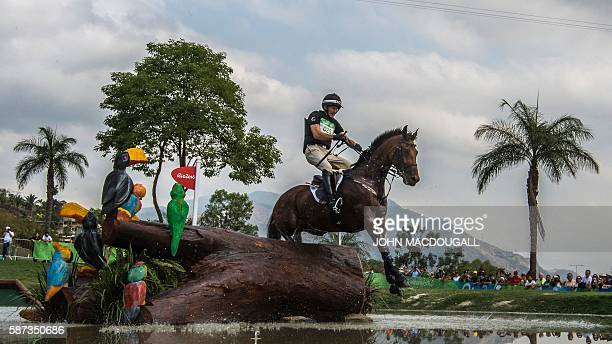 New Zealand's Mark Todd competes in the Eventing's Cross Country phase of the Equestrian competition during the Rio 2016 Olympic Games at the Olympic...