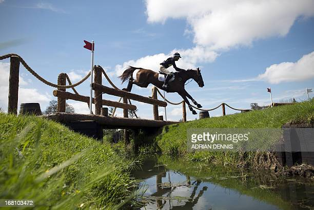 New Zealand's Mark Todd riding Major Milestone jumps the World Horse Welfare Footbridge jump during the cross country test during day three of the...