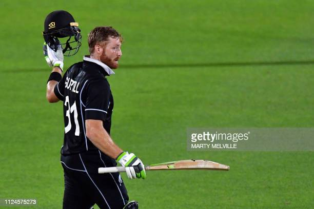 New Zealand's Martin Guptill celebrates reaching his century during the first oneday international cricket match between New Zealand and Bangladesh...