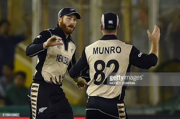 New Zealand's Martin Guptill celebrates with Colin Munro after taking the catch of Pakistan's Ahmed Shehzad during the World T20 cricket match...