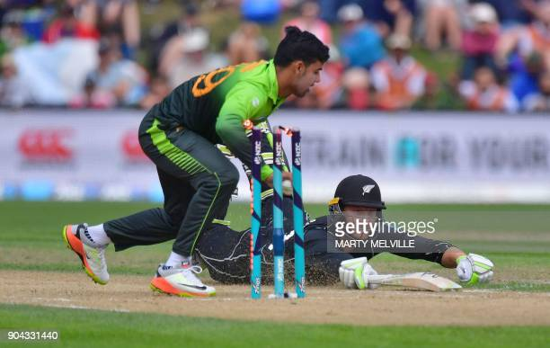 New Zealand's Martin Guptill is run out by Pakistan's Shadab Khan during the third one day international cricket match between New Zealand and...