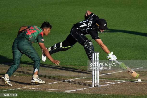 New Zealand's Martin Guptill makes his ground successfully after a runout attempt by Bangladesh's Mohammad Saifuddin during the first oneday...