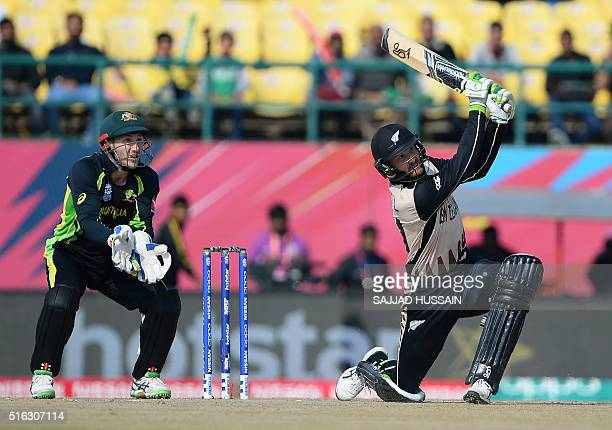 New Zealand's Martin Guptill plays a shot as Australia's wicketkeeper Peter Nevill looks on during the World T20 cricket tournament match between...