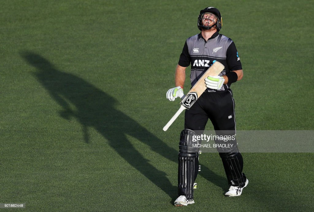 New Zealand's Martin Guptill reacts after being hit by the ball during the final Twenty20 Tri Series international cricket match between New Zealand and Australia at Eden Park in Auckland on February 21, 2018. /