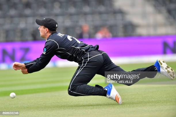 New Zealand's Matt Henry drops a catch off the bat of West Indies' captain Jason Holder during the third oneday international cricket match between...