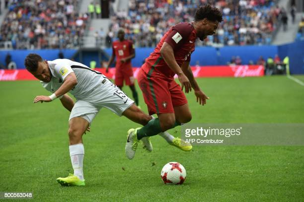 New Zealand's midfielder Clayton Lewis vies with Portugal's defender Eliseu during the 2017 Confederations Cup group A football match between New...