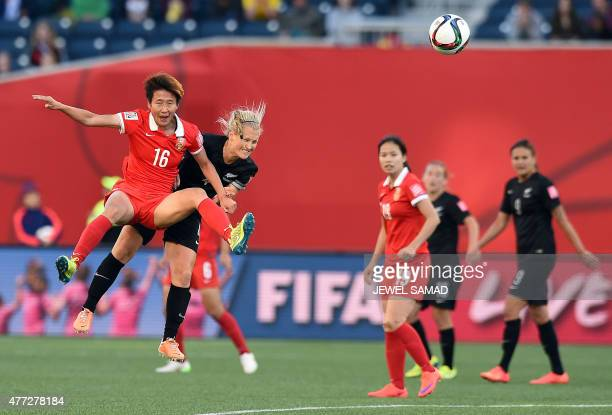 New Zealand's midfielder Katie Duncan and China's forward Lou Jiahui collide during their Group A football match of the 2015 FIFA Women's World Cup...