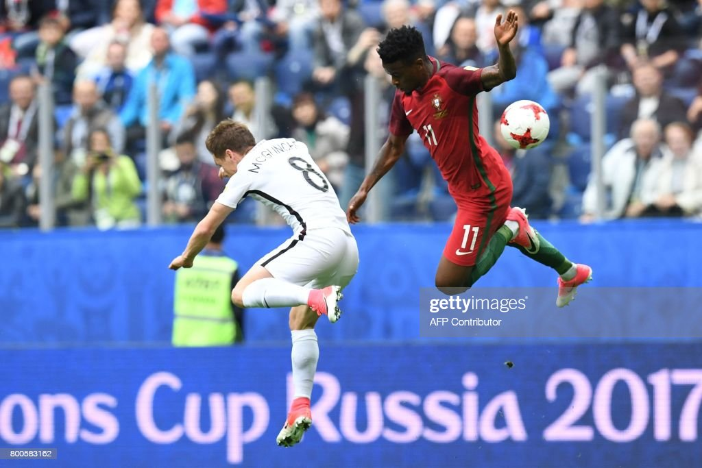 New Zealand's midfielder Michael McGlinchey (L) vies with Portugal's defender Nelson Semedo during the 2017 Confederations Cup group A football match between New Zealand and Portugal at the Saint Petersburg Stadium in Saint Petersburg on June 24, 2017. / AFP PHOTO / Kirill KUDRYAVTSEV