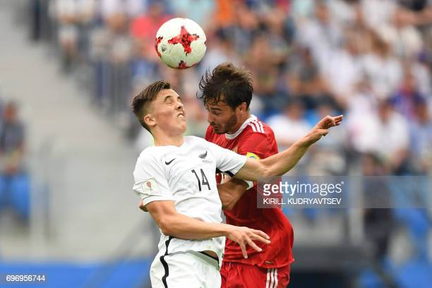 New Zealand's midfielder Ryan Thomas vies for the ball against Russia's midfielder Alexander Erokhin during the 2017 Confederations Cup group A...