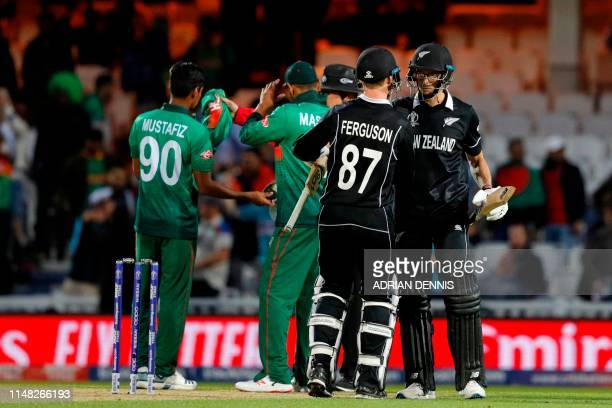 New Zealand's Mitchell Santner and New Zealand's Lockie Ferguson celebrates after the 2019 Cricket World Cup group stage match between Bangladesh and...