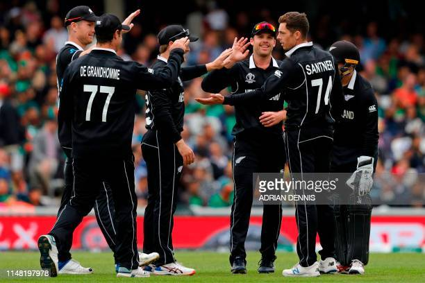 New Zealand's Mitchell Santner celebrates with teammates after taking the wicket of Bangladesh's Mahmudullah during the 2019 Cricket World Cup group...