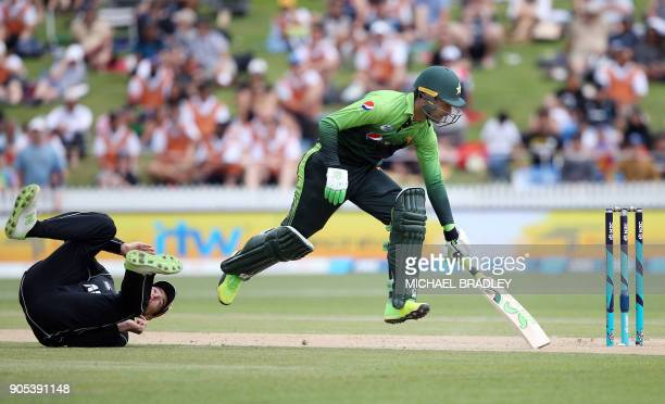 New Zealand's Mitchell Santner is unable to run out Pakistan's Fakhar Zaman during the fourth oneday international cricket match between New Zealand...