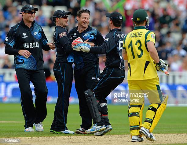 New Zealand's Nathan McCullum celebrates after taking the wicket of Australia's Matt Wade during the 2013 ICC Champions Trophy cricket match between...