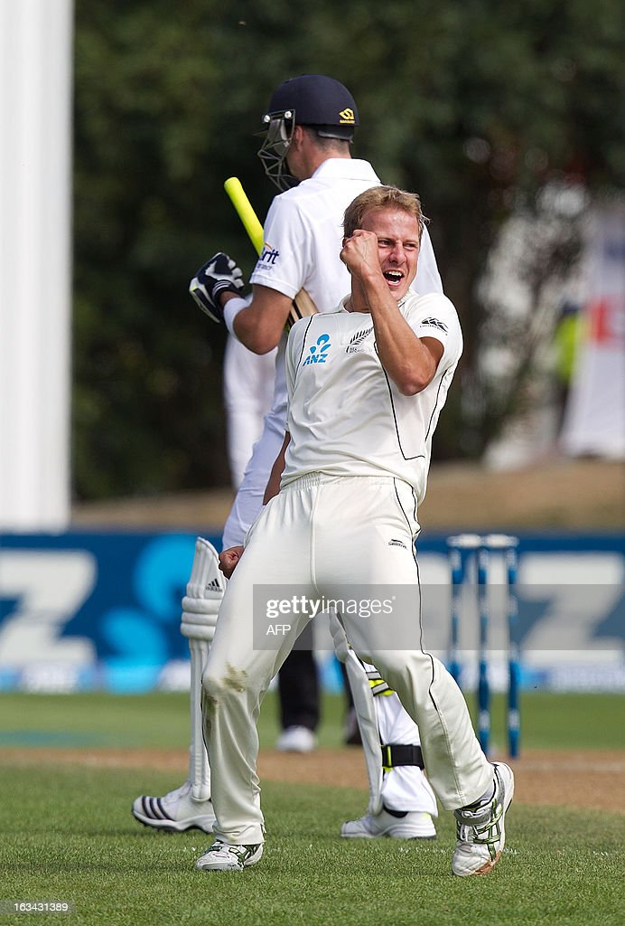 New Zealand's Neil Wagner (front) celebrates as England's Kevin Pietersen walks from the field after being caught out during day five of the first international cricket test match between New Zeala...