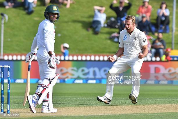 New Zealand's Neil Wagner celebrates Bangladesh's Mehedi Hasan Siddique being caught Bangladesh's Sabbir Rahman bats during day two of the first...
