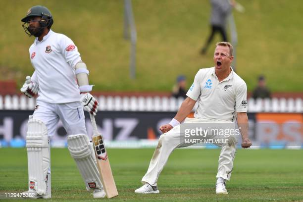 New Zealand's Neil Wagner celebrates Bangladesh's Mohammad Mithun being caught during day three of the second Test cricket match between New Zealand...