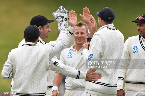 New Zealand's Neil Wagner celebrates Bangladesh's Tamim Iqbal Khan being caught with teammates during day three of the second Test cricket match...